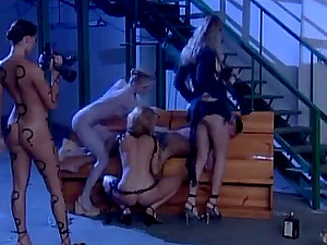Four sexy chicks get fucked by a fellow on the stairs
